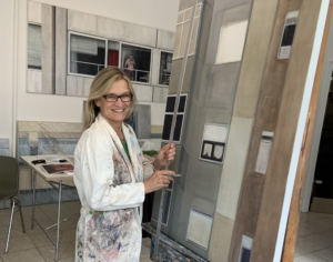 Susanna Storch in her studio, painting on a big canvas